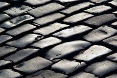 Texture grise des lignes du pavé en pierre Images libres de droits