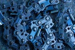 Texture grise en métal des maillons de chaînes de tronçonneuse photographie stock