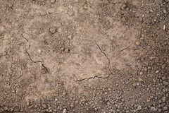 Texture of the ground ready for planting. Wet and dry land, the view from the top. royalty free stock photo