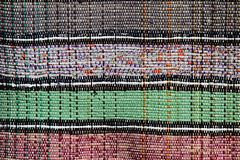 Texture of handmade carpet made on hand-loom with four different colours divided with twin vertical lines Stock Image