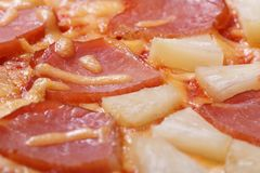Texture Hawaiian pizza with pineapple and ham Royalty Free Stock Image