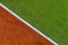 Texture of the herb cover sports field. Used in tennis, golf, baseball, field hockey, football, cricket, rugby. royalty free stock images