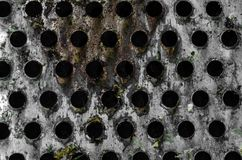 Texture of the holes of the old metal float Royalty Free Stock Image