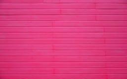 Texture horizontale de mur en bois rose Photographie stock