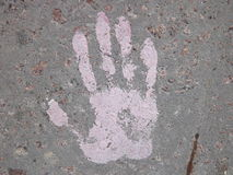 Texture of a human hand print on the concrete surface. Texture of a human hand  paint print on the concrete surface Royalty Free Stock Photography