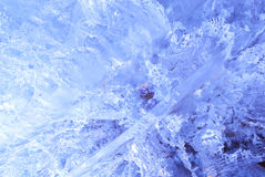 Texture of ice  with blue back light. Royalty Free Stock Photography