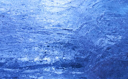 Texture of ice  with dark blue back light. Royalty Free Stock Images