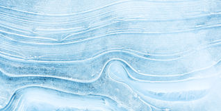 Texture of ice on the frozen lake. Blue color background. Stock Photos