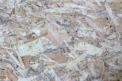 Texture image of osb board. Beautiful beautiful pattern on oriented strand board. Background, abstract, structure, wooden, plywood, pressed, closeup, natural stock photography