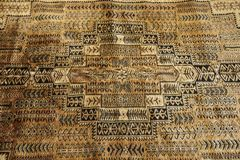 Texture of indian traditional wool carpet with geometric pattern. India Stock Images