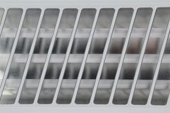 Texture of infrared heater tubes with stainless shiny grid on top royalty free stock images