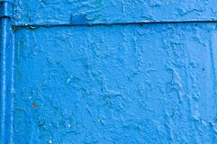 The texture of the iron metal painted blue paint shabby old shabby scratched cracked ancient metal sheet wall. The background royalty free stock photography