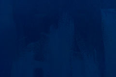 The texture of iron painted in blue. Brush strokes. royalty free stock photography