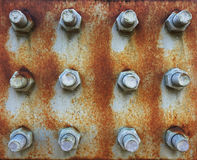 Texture of iron plate with screws Stock Image