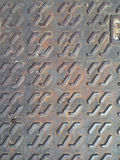 The texture of the iron sewer hatch. Textures Royalty Free Stock Photo
