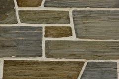 Texture irrégulière de plan rapproché de mur de briques de schiste Photographie stock
