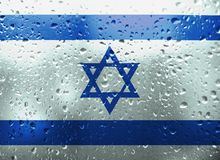 Texture of Israel flag. Texture of Israel flag on the glass with drops of rain at dawn stock images