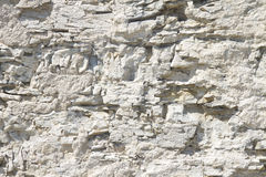 Texture of a jagged white stone wall Stock Photos