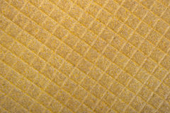 Texture jaune de fond d'un tissu rugueux Photo libre de droits