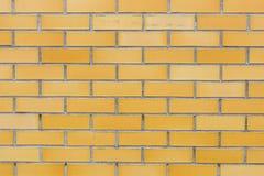 Texture jaune de fond de mur de briques Photographie stock libre de droits