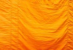 Texture jaune de robe longue Photographie stock libre de droits