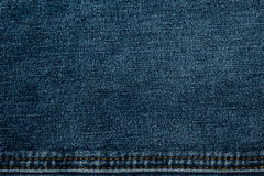 Texture of jeans fabric in high resolution. With a suture thread yellow Royalty Free Stock Photo