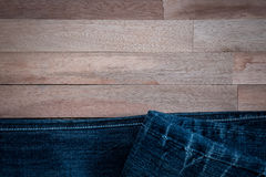 Texture of jeans on wooden background Stock Photo