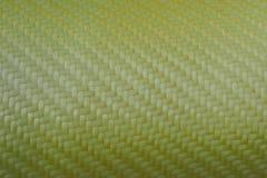 Texture of Kevlar Fiber. Precious gold material Royalty Free Stock Image