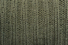 Texture of khaki knitted wool sweater with ornament Royalty Free Stock Images