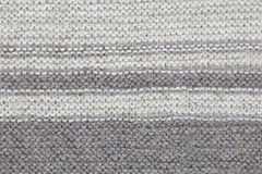 The texture of a knitted brown cloth with stripes. purl and facial loop royalty free stock image
