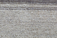 The texture of a knitted brown cloth with stripes. purl and facial loop stock photos