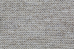 The texture of a knitted brown fabric. Alternating rows stock photos