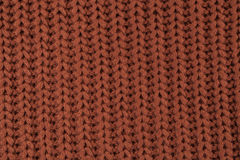 Texture of knitted brown fabric macro. A tissue sample Stock Photo