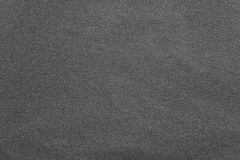 Texture knitted fabric of dark gray color Royalty Free Stock Photos