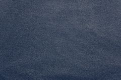 Texture knitted fabric of dark violet color Stock Photos