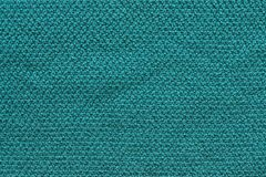 Texture knitted fabric of green color Royalty Free Stock Photos