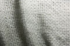 Texture of knitted fabric in a mesh with folds. Close Stock Image