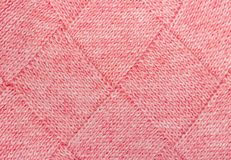 Texture of knitted fabric of pink woolen threads. Stock Image