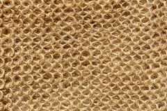 The texture of the knitted fabric from the threads of natural wool fibers.  stock photos