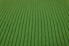 Texture of knitted green fabric macro. A tissue sample Royalty Free Stock Image