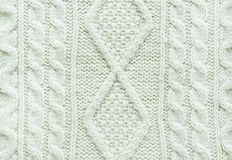 Texture of knitted handmade. Christmas white sweater close up. Wallpaper or abstract background. Top view Stock Images