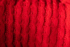 Texture of knitted red wool. background for design or Wallpaper stock image