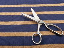 Texture of knitted wool cotton striped fabric and scissors. Royalty Free Stock Photos