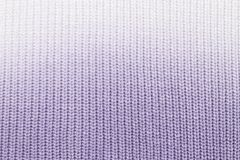 The texture of a knitted woolen fabric blue stock photo