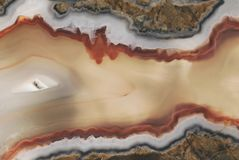 Texture of a large polished agate stone of chalcedony close-up in section cut Stock Photo