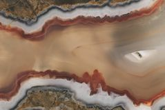 Texture of a large polished agate stone of chalcedony close-up in section cut Stock Images