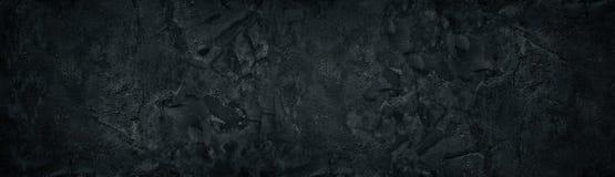 Texture large approximative noire de mur en b?ton L'amende a donn? au panorama une consistance rugueuse criqu? de surface de pl?t photo stock