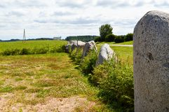 The texture of a large garden garden of stones of round stones standing in a row in order on a favorable background background royalty free stock photos