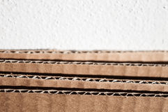 Texture of layered brown cardboard side. Folded cardboard boxes Stock Photo