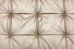 Texture of leather beige sofa upholstery as background royalty free stock image